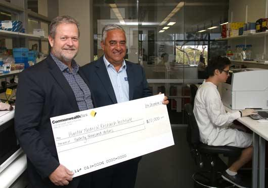 George Rafty presents Professor Michael Nilsson with cheque for 20000