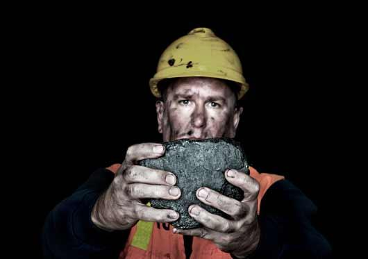 man holding coal